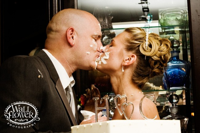 Bride and Groom feeding cake to each other ….to smash or not to smash …